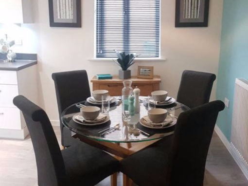 teal and grey showhome dining area