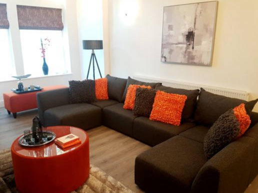 orange and charcoal grey showhome design