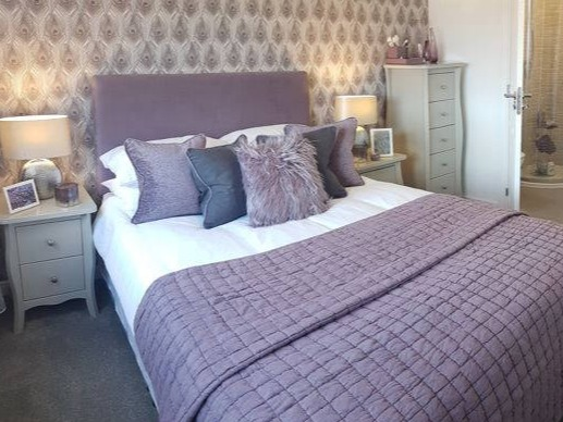 heather and grey showhome bedroom