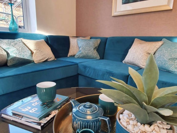 teal and soft gold lounge