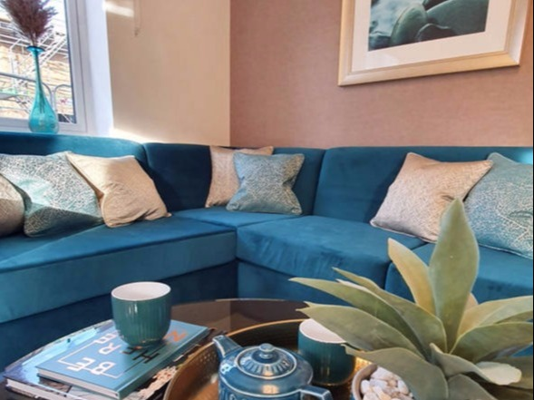 teal and soft gold showhome lounge